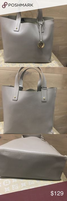 "NWT Furla Tote Handbag gray  Musa tote medium size The classic tote shape has been reinvented in PVC, graphic prints and rich colors with Furla's line of tote bags, to give the classic style of bag a modern spin and chic new twist for a more exciting feel. The family-run label specializes in creating upscale accessories, bags and shoes that are all of Italian design, for a signature style that is evident across the range of tote bags. premium leather  Body length 9"", height 8.5"", width 4.5""…"