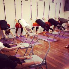 "Adho Mukha Svanasana with a bolster a chair and two blocks. This special variation teaches how to make the quadriceps ""flat"" on the femur bone and the action of keeping the femur bones back in crucial Asana like Adho Mukha Svanasana, Parsvottanasana, Virabhadrasana 1, Parivrtta Trikonasana. #yoga #iyengar #yengaryoga #yogini #yogateacher #yogastudio #yogagram #yogafam #yogaitalia #yogaitaly #yogawithachair #yogaprops #yogapertutti"
