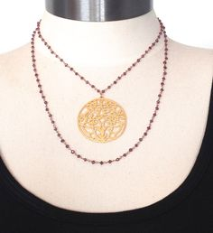 Gold and Garnet is a Necklace with an 18k over Bronze Filigree Pendant on a 36″ long Chain of Gold-Fill and Garnets with a Sterling Silver Chain Extender Provided for Choices in How to Wear.  This Necklace is Designed so You can wear it Long, or you can Double up the Chain and Showcase the Pendant at Your Neckline as shown in the Photos.