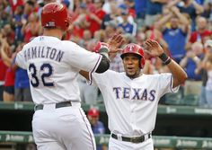 Texas Rangers designated hitter Josh Hamilton (32) is greeted by Texas Rangers shortstop Elvis Andrus (1) at the plate after hitting a three-run homer in the first inning during the New York Yankees vs. the Texas Rangers major league baseball game at Globe Life Park in Arlington on Thursday, July 30, 2015. (Louis DeLuca/The Dallas Morning News)