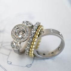 custom stacking diamond rings in platinum & green gold handmade by J ALBRECHT DESIGNS in Boulder, Colorado