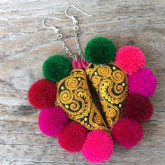 A pair of handmade pom pom earringsHippie Boho Style by AtSiam