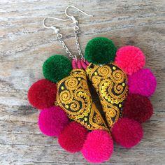 A pair of handmade pom pom earringsHippie Boho Style by AtSiam