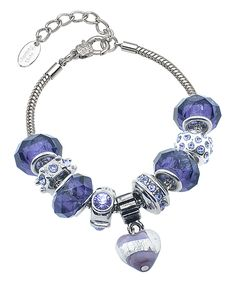 Purple Swarovski® Crystal Murano Marble Heart Charm Bracelet. . ..  Golden Moon. . ..  $12.49 $130.00  .   Product Description:  Bring a whimsical touch to your look with this bracelet, featuring a dazzling white gold-plated chain. Charms embellished with crystals from Swarovski® elevate the piece for an eye-catching sparkle.      7'' L with 1.5'' extender  .     Lobster claw clasp  .     18K white gold-plated stainless steel / Swarovski® crystal  .     Imported