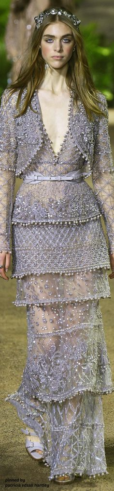 cannot stand the dress as a whole but I love the details...the beading!