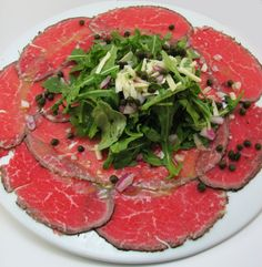 Carpaccio is the international name of a typical Italian dish made with raw meat. The dish was proposed with this name for the first time in Venice, at the time of an exhibition dedicated to Veneti…