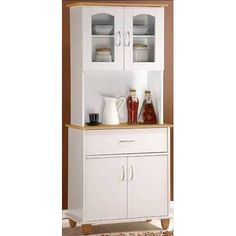 Features:  -Great for extra storage in the kitchen and dining room.  -Cabinet does not have a hole for a cord.  -Can accommodate a microwave on countertop.  -Bottom cabinet includes 1 shelf.  -Cannot