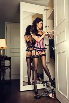 Sexy pink and black corset lingerie & thong with garter belt and sheer thigh highs.