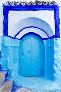 This is a picture of the beautiful mountain village of Chefchaouen Morocco.  The entire village has painted their doors blue.