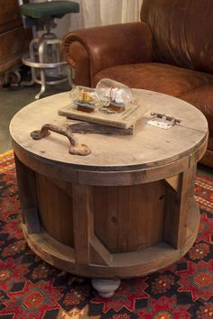 Ideas For Creating Upcycled Tables, Desks and Workstations: This old cheese mold, found at an antiques sale, has been repurposed into a coffee table. The handle opens an interior that makes for a great storage space. From DIYnetwork.com