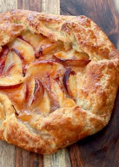 In a pie, the filling is the hero. In a tart however, it's all about the crust! Our rustic peach tart recipe is outstanding any way you slice it! Our rustic peach tart recipe has the most amazing crust on the planet—and the filling isn't bad either! Peach Tart Recipes, Sweet Recipes, Peach Galette Recipe, Crostata Recipe, Recipes With Peaches, Nectarine Recipes, Passionfruit Recipes, Apple Galette, Pear Recipes