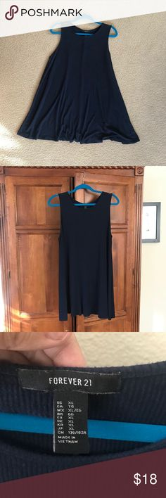 Forever 21 Ribbed Navy Blue Short Dress / Tunic Super cute forever 21 tunic! Size XL. Fits like a short dress or a long shirt. I wore it once and never picked it back up again, so here it is!   Please zoom in to see details. Feel free to ask any further questions!   I'm open to negotiate through the offer feature; I'm studying abroad and need to sell all of these treasures I've neglected to help fund my trip! Thanks for shopping :) Forever 21 Tops Tunics
