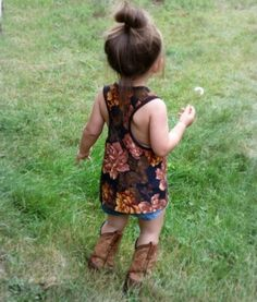 Her boots and hair in a bun <3 Oh my gosh shes so cute.