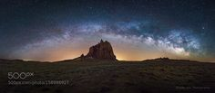 Shiprock  This is another view of Shiprock I took on the same night of my other Shiprock picture. With Planit for photographers app we knew exactly what we could get at a given location. When we were scouting the area earlier we marked this point on PlanIt because we wanted to have the mono rock displayed by itself under milky way arch. Soon after 12 am when milky way just rise up we got out of our car and moved to this point quickly. With a few tries I started to shoot pano. I wasn't sure…