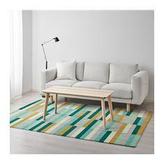 Färgglad matta kan passa till de mörkgrå fåtöljerna. //: KRÖNGE Matta, kort lugg - IKEA