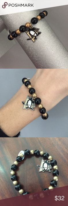 """Pittsburgh Penguin bracelet Black and gold glass beads with licensed NHL Pittsburgh Penguin charm. Black beads are polished round (8mm), gold are brushed round (6mm). Bracelet is stretch, 6 1/2"""" length Jewelry Bracelets"""