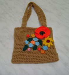 crocheted purse with floral applications
