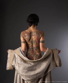 Dragon Tattoo Lady. What a very yakuza like tattoo. I like the pose too.