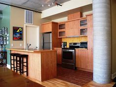 Stunning wood cabinetry. The perfect modern loft kitchen. Inclusions: Fridge, stove, dishwasher, washer, dryer, blinds, light fixtures of a permanent nature, AC- all for sale without legal warranty (5/10)