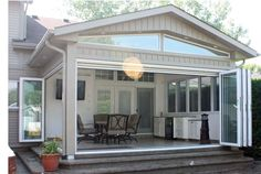 Love this covered porch with outdoor kitchen - would be great for a lake house