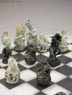 Chess Set - Theme: Mechanical World vs Natural World  by Gil Bruvel.  (most awesome chess set I've ever seen!)