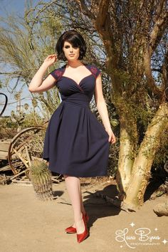 The Luscious Dress from Pinup Couture is the grown up answer to the baby doll dress: much more flattering fitted waist and a longer height. Made from a thick high quality cotton in Navy: it doesn't have a zip and goes on over your head.