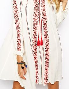 Swing Dress With Long Sleeves And Embroidery. It is very similar to Ukrainian national costume