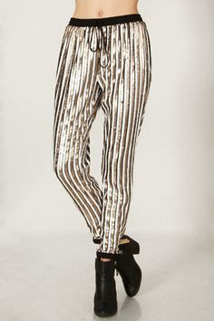 Must have White and Gold Sequin striped jogger style pants.  Wear these pants during the day or night.  Fabric: Self: 100% Polyester. Contrast: 95% Polyester, 5% Spandex. Lining: 100% Polyester  Hand Wash ONLY