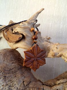 Flower Star. Olive wood necklace by ValleyWWKing on Etsy