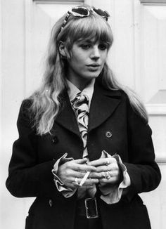 1960s singer-songwriter Marianne Faithfull wearing black trench coat and blouse with ruffles - #tomboy