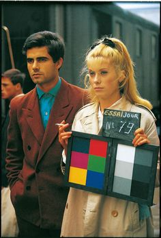 Nino Castelnuovo and Catherine Deneuve on the set of the beautiful color film The Umbrellas of Cherbourg (1964).