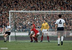 Bobby Moore at the centre of the England defence during the FIFA World Cup Final between England and West Germany at Wembley Stadium in London 1958 World Cup, 1966 World Cup Final, Germany National Football Team, Germany Team, Bobby Moore, England Football, Retro Football, Wembley Stadium, Europa League