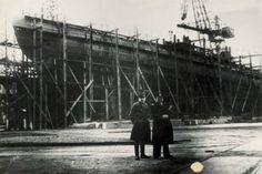 Year 1945 - Russian officers in Gdańsk Shipyard (Schichau Werft) with U-boot submarine in background.