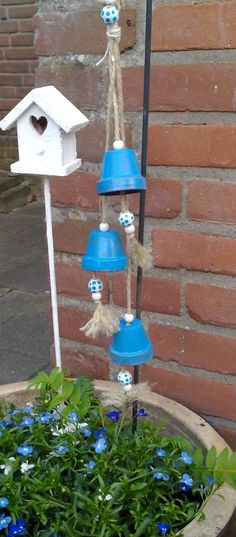 DIY Garden Art made of clay pots and wooden beads, painted in marine blue colour to match the flowers of Lobelia. Wind chime, repurposing & fun