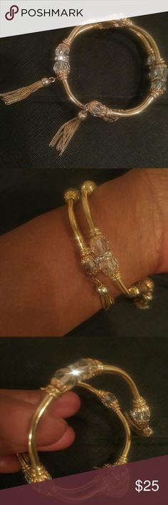 Vintage Gold One Size Wrap Crystal Bracelet Vintage Gold One Size Wrap Crystal Bracelet with Tassels. This will fit any size. Beautiful Condition! Stunning Crystal Stones and Rhinestones. No Discoloration and Full of Bling ..No Missing Stones. A Real Beauty! Not Signed. Vintage Jewelry Bracelets