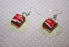 cake earrings on lace