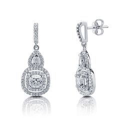 "These beautiful double halo cushion dangle earrings are made of fine sterling silver, stamped with a ""925"" quality mark and rhodium plated. Set with 2 high quality cushion cut 4-prong set cubic zirconia (0.92 carat, 5mm). Accented with 2 pear cut 3-prong set CZ (0.7 carat, 5mm x 4mm) and 138 small round cut micro pave set CZ. Stones total weight is 2.31 carat. Earrings measure 1.2 inch L x 0.5 inch W. Edge posts with butterfly backs for pierced ears. Style: e982"