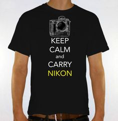 KEEP CALM and CARRY NIKON with a D3x at the top.       This is a unisex size, women may prefer to order one size smaller.      If you have any questions please contact us.    Thanks and have a great day.