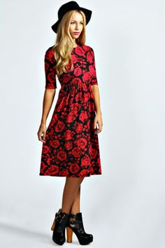 Mila Rose Print Midi Dress with chunky cut out ankle boots and hat.