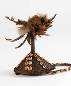 Headwear Lega, Democratic Republic of Congo fibers woven, feathers, cowries. High: 21 cm Bibliography: Secrets d'Ivoire-Art-Museum of Central Africa Lega Quai Branly-Actes Sud, 2013. (page 95- Fig 53)