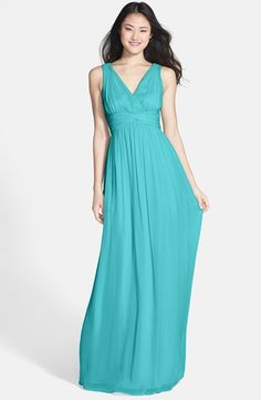 Free shipping and returns on Donna Morgan 'Julie' Twist-Waist Silk Chiffon Gown (Regular & Plus) at Nordstrom.com. A ruched twisted waistband accentuates the sumptuous surplice bodice atop an elegant chiffon gown balanced by a floating, floor-sweeping skirt.