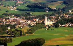 Conco is a tiny village with a population of just under 3,000.  The Asiago Plateau is the largest plateau in the Eastern Alps of Italy.      Read more: http://www.dailymail.co.uk/news/article-2102393/Village-clouds-Beacon-light-shines-mist-spectacular-Alpine-setting.html#ixzz1mmC717jg