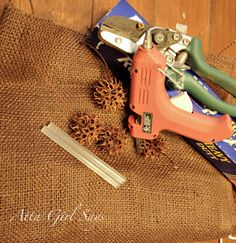 Sweet Gum wreath... I would use the twisted paper for a prettier bow.. mb