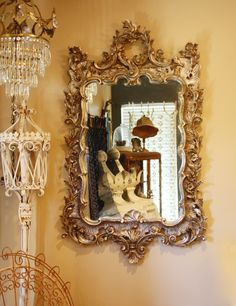 "Incredible Antique Italian Hand Carved Xlrg Antique Mirror  This mirror is simply breathtaking. A very rare mirror, solid wood hand carved made in Italy and marked. With the original silver gilt that has aged with grace to give it such a beautiful patina. The original mirror is very clear and thick. This is a stunning mirror that would be beautiful in an entry way, over a mantle or in a grand master suite bathroom.  Measurements are 55"" tall by 32"" wide"