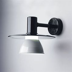 Stockholm, a modern and smart outdoor lamp to assemble on wall. Frame and shades are made of black/grey painted aluminium.