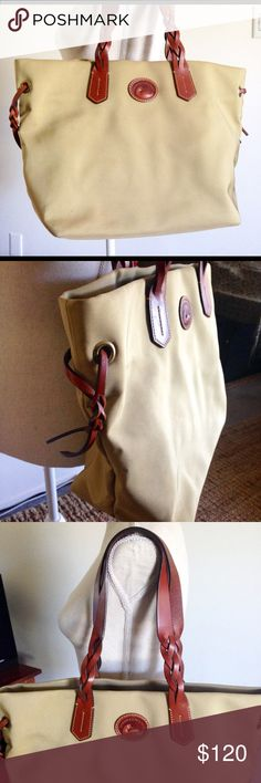 Dooney & Burke Khaki Tan Tote Dooney & Burke hard to find Khaki Tote Only worn once in Italy In excellent links new condition Leather handle and accents. Lovely Tote!! Dooney & Bourke Bags Totes