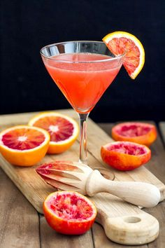 This Blood Orange Martini recipe has fresh blood orange juice, pear vodka, ginger liqueur and limoncello. Unique and tasty! This Blood Orange Martini recipe has fresh blood orange juice, pear vodka, ginger liqueur and limoncello. Unique and tasty! Cocktail Party Food, Party Drinks, Cocktail Drinks, Fun Drinks, Cocktail Recipes, Beverages, Campari Cocktails, Healthy Drinks, Orange Martini Recipes