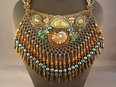 """""""Princess of Antiquity"""" By iamcr8ve.  Bib necklace, semi-precious stones, fossils and beads.  Not a piece you could wear often, but still pretty neat looking!"""