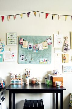 Decorated creative workspace with bunting for extra beauty.