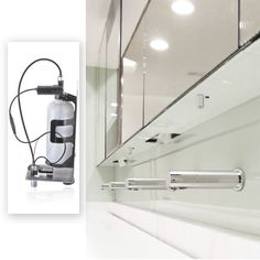 integrated tissue and soap dispenser in mirror - Google Search